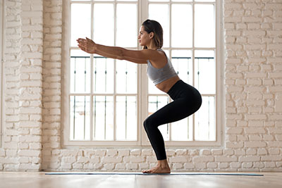Exercice Yoga musculation le squat